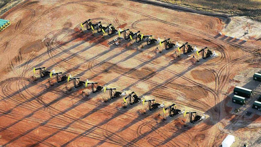 Eighteen oil pumpjacks are seen on a Hess well pad near Tioga
